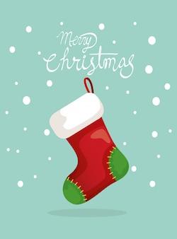 Tarjeta de feliz navidad con calcetín colgando