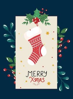 Tarjeta de feliz navidad con calcetín y hojas decorativas
