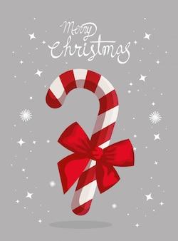 Tarjeta de feliz navidad y caña dulce con lazo de cinta