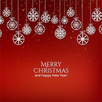 Tarjeta de feliz navidad copos de nieve colgando bolas en rojo