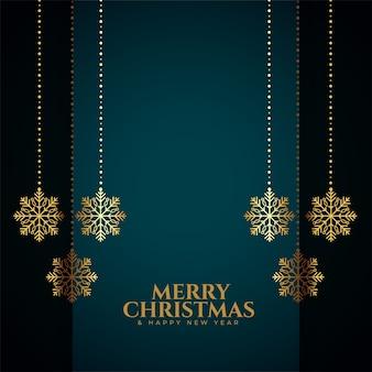 Tarjeta de feliz navidad con decoración de copos de nieve dorados