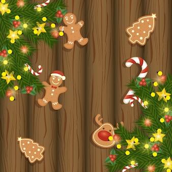 Tarjeta de feliz navidad con dulces galletas de jengibre en madera