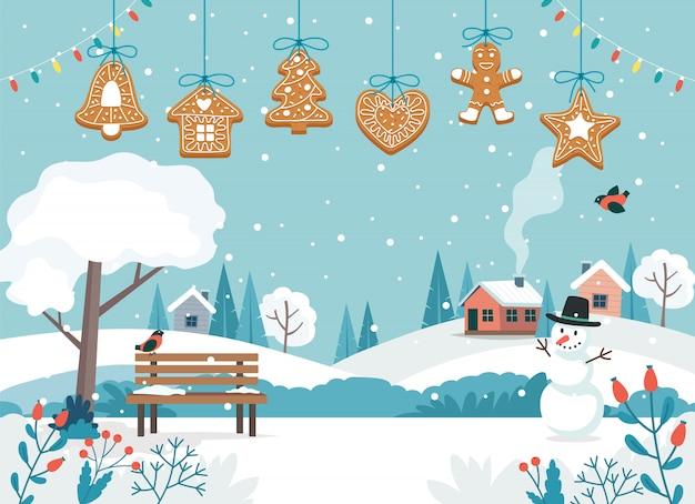 Tarjeta de feliz navidad con lindo paisaje y colgando galletas de jengibre.