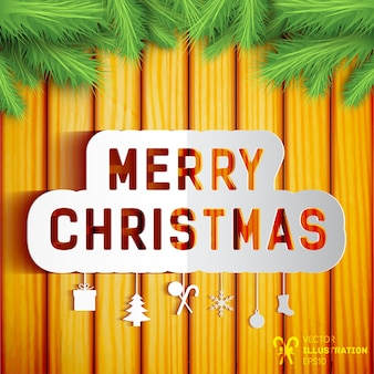 Tarjeta de feliz navidad con símbolos de invierno en la pared de madera decorada con ramas de abeto