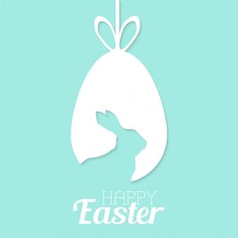 Tarjeta de feliz pascua con huevo y conejo