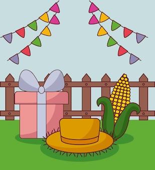 Tarjeta de festa junina con sombrero de paja, caja de regalo y mazorca de maíz