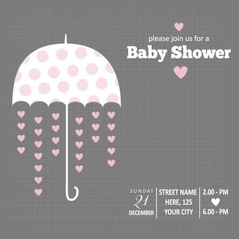 Tarjeta para la fiesta del bebé con un paraguas y corazones