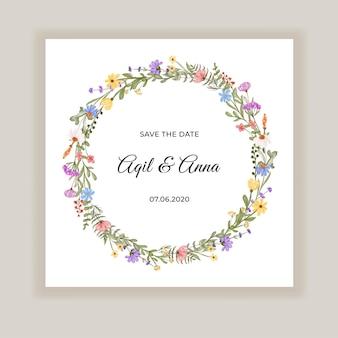 Tarjeta de invitación de boda con corona de flores silvestres