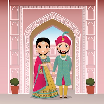 Tarjeta de invitación de boda la linda pareja de novios en personaje de dibujos animados de vestido indio tradicional