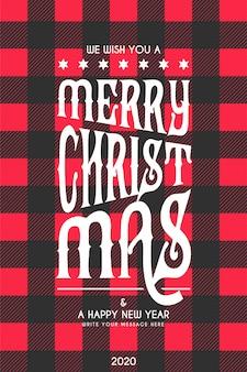 Tarjeta de letras navideñas con patrón de tartán negro y rojo