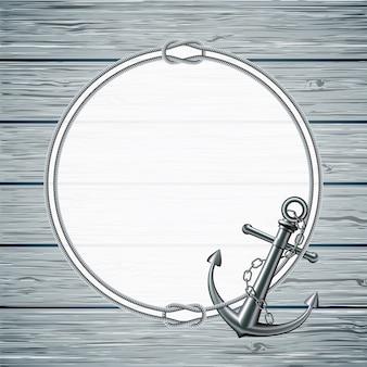 Tarjeta náutica con marco de la cuerda y ancla