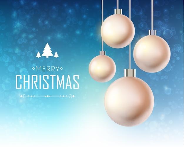 Tarjeta de navidad con adornos navideños colgantes realistas e inscripción en azul brillante