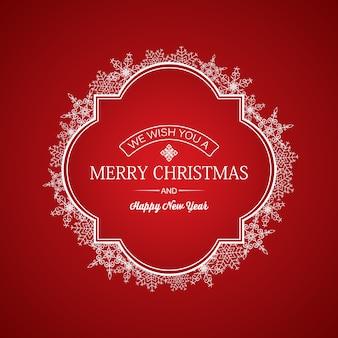 Tarjeta de navidad y año nuevo con inscripción de saludo en marco y copos de nieve blancos sobre rojo