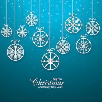 Tarjeta de navidad con copos de nieve colgantes bola de fondo