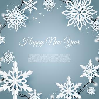 Tarjeta de navidad con copos de nieve de papel, copos de nieve cayendo sobre un fondo azul