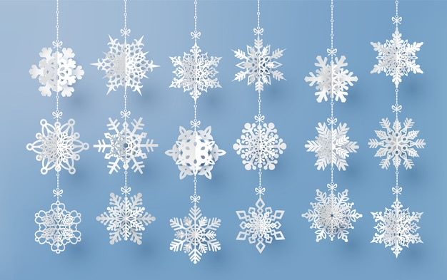 Tarjeta de navidad con copos de nieve de papel cortado
