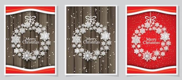 Tarjeta de navidad con copos de nieve de papel. figura circular.