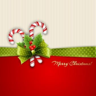 Tarjeta de navidad con hojas de acebo y dulces