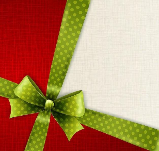Tarjeta de navidad con lazo de lunares verdes