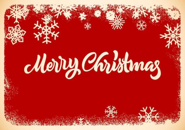 Tarjeta de navidad con letras dibujadas a mano y copos de nieve.