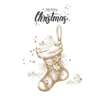 Tarjeta de navidad con mano alzada doodle calcetín dorado de navidad y brillo.