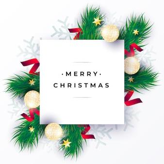 Tarjeta de navidad realista con ramas verdes