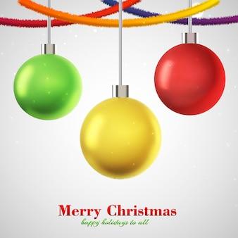 Tarjeta de navidad tres bolas de colores colgantes