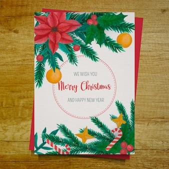 Tarjeta navideña con decoración de muérdago acuarela.
