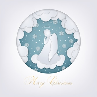 Tarjeta navideña con nubes, copos de nieve y un pequeño ángel al estilo de papel en capas. marco azul redondo. un lindo ángel rezando en un cielo nevado de invierno. tarjeta de felicitación feliz navidad estilo de corte de papel.