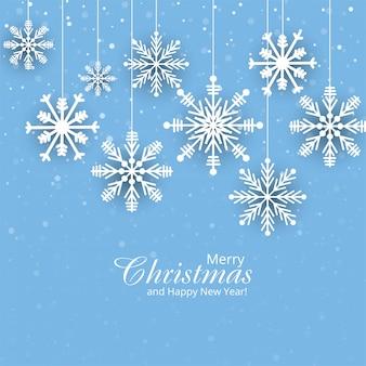 Tarjeta de papel de navidad con copos de nieve colgantes de fondo