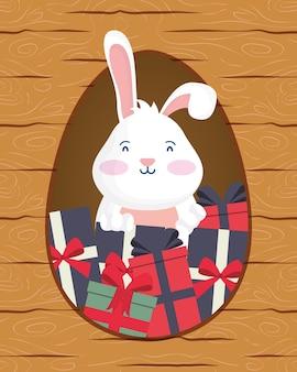 Tarjeta de pascua feliz con conejo y regalos en diseño de ilustración de vector de escena de marco de madera