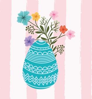 Tarjeta de pascua feliz con huevo pintado y flores