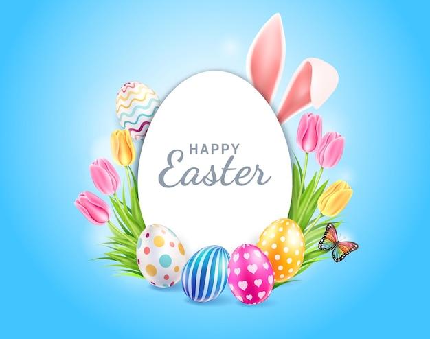 Tarjeta de pascua feliz con orejas de conejo, flores de tulipanes y mariposas sobre fondo de color azul.