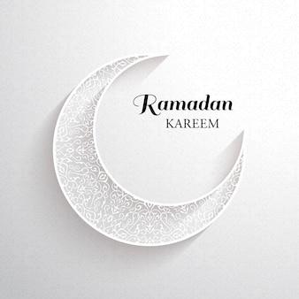 Tarjeta de ramadán kareem. luna ornamental blanca con sombra y la inscripción negra ramadan kareem sobre un fondo claro.