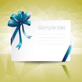 Tarjeta de regalo blanca en blanco con lazo de cinta azul y campo de texto