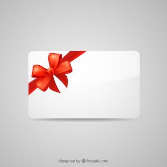 Tarjeta de regalo en blanco con cinta roja