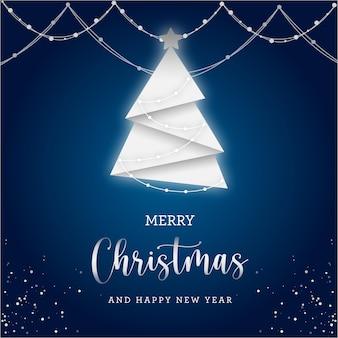 Tarjeta de regalo de feliz navidad con luces y árbol blanco sobre fondo azul.
