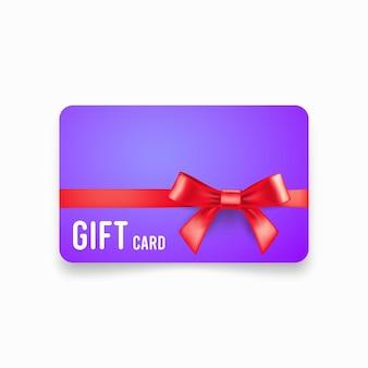 Tarjeta de regalo con lazo rojo y cinta aislada