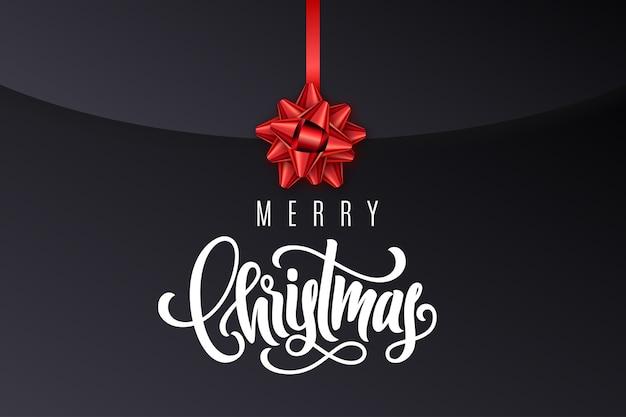 Tarjeta de regalo navideña con letras a mano feliz navidad y lazo rojo