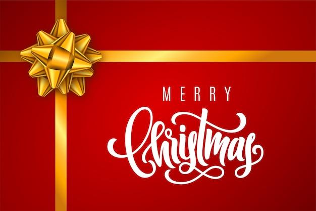 Tarjeta de regalo navideña con letras a mano feliz navidad y lazo