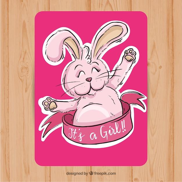 Tarjeta rosa de bienvenida al bebé con conejito lindo