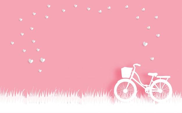 La tarjeta de san valentín con en bicicleta y corazón flotante en papel corta estilo ilustración vectorial