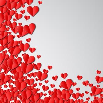 Tarjeta de san valentín con corazones de papel cortado dispersos