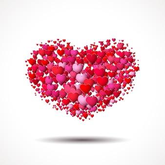 Tarjeta de san valentín con forma de corazón hecha de pequeños símbolos de amor dispersos
