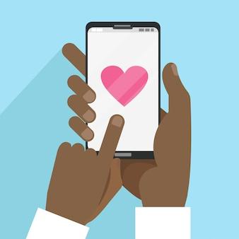 Tarjeta de san valentín con manos masculinas negras con teléfono inteligente con corazón en estilo de dibujos animados plana.