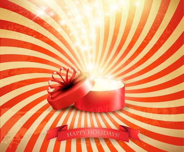 Tarjeta de vacaciones de navidad retro con caja de regalo abierta y fuegos artificiales de luz mágica.