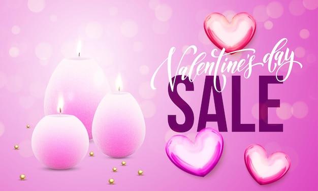 Tarjeta de venta del día de san valentín de corazones y velas sobre fondo de luces brillantes de brillo rosa premium