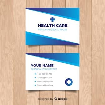Tarjeta de visita con concepto médico en diseño flat