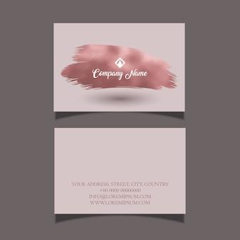 Tarjeta de visita elegante con un diseño de trazo de pincel de oro rosa