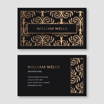 Tarjeta de visita con elegantes elementos dorados.
